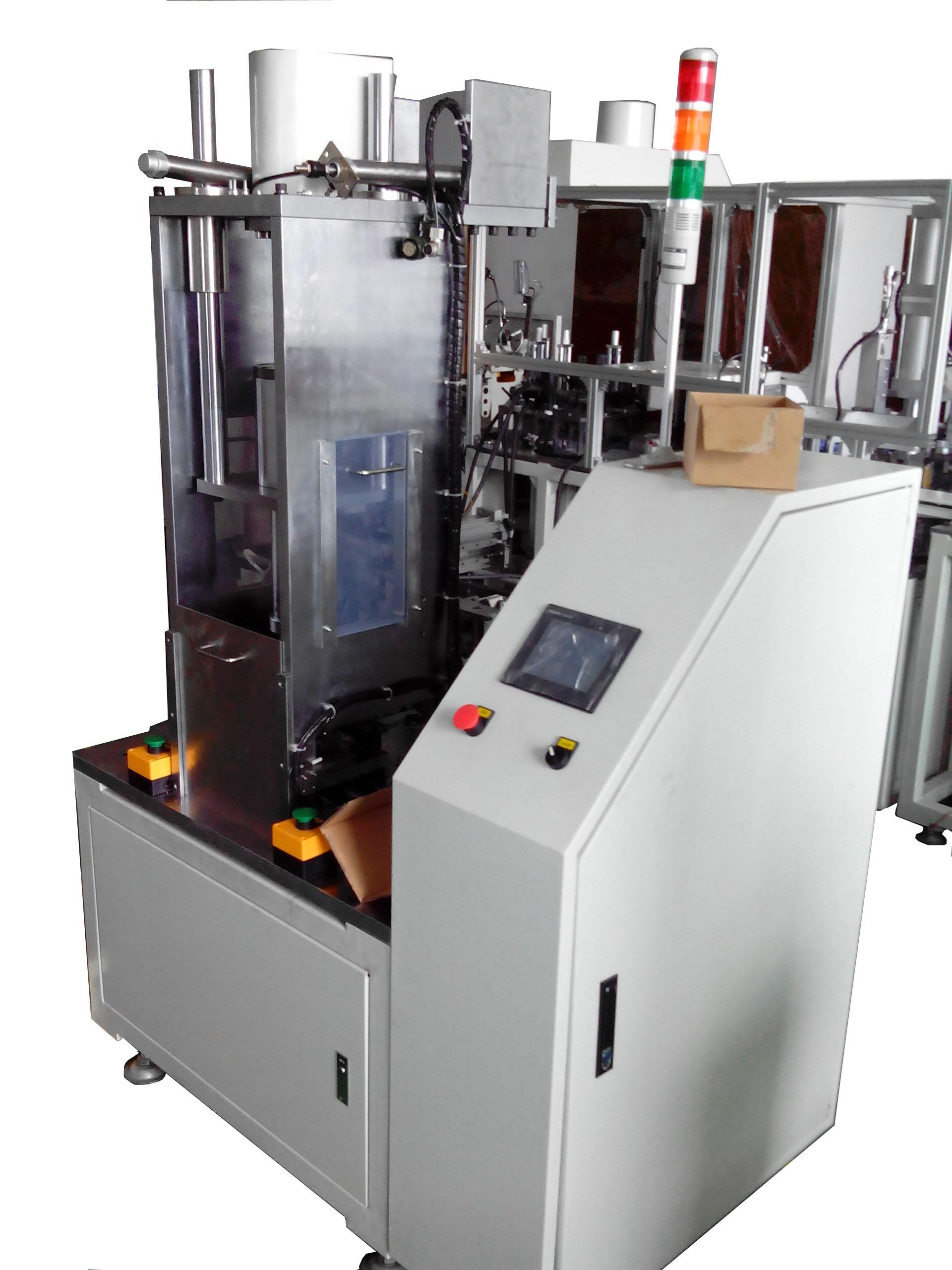 磁控管散热片组装机
